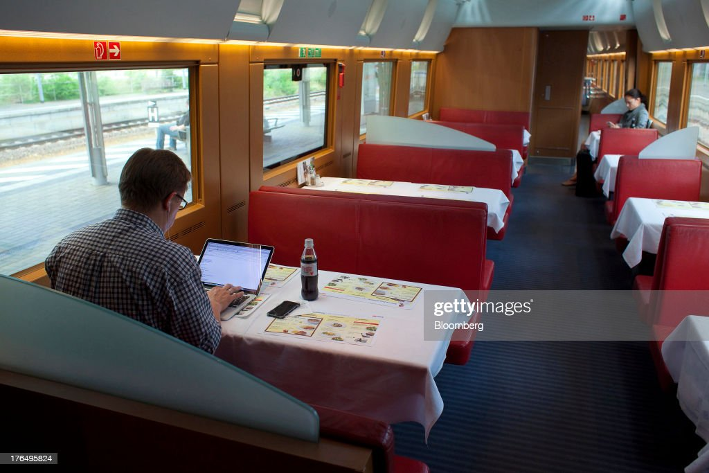 A passenger uses a laptop computer as he sits in the dining carriage of an InterCity Express (ICE) train, operated by Deutsche Bahn AG, as it travels between Berlin and Leipzig in Germany, on Tuesday, Aug. 13, 2013. German gross domestic product rose 0.7 percent from the first quarter and the French economy expanded 0.5 percent, the countries' national statistics offices said today. Photographer: Krisztian Bocsi/Bloomberg via Getty Images