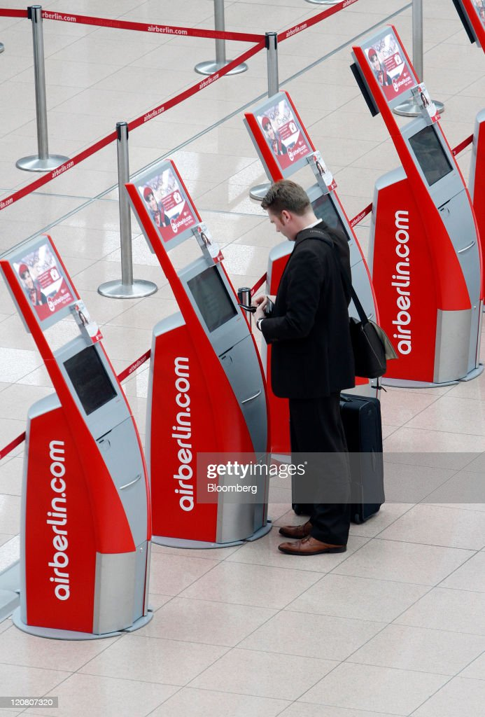A passenger uses an Air Berlin Plc self check-in machine at Hamburg airport, operated by Hochtief AG, in Hamburg, Germany, on Wednesday, Aug. 10, 2011. Vinci SA, Europe's biggest builder, and Fraport AG are leading the bids for Hochtief AG's airport-operating business, each offering more than 1 billion euros ($1.4 billion), said four people familiar with the process. Photographer: Michele Tantussi/Bloomberg via Getty Images