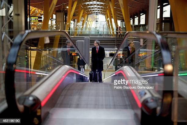 A passenger uses the escalator at Madrid Barajas Adolfo Suarez airport which is operated by group Aena on February 11 2015 in Madrid Spain Shares in...