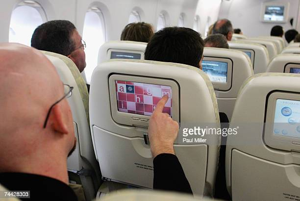 A passenger uses the inflight entertainment on an Airbus A380 during it's first Australian passenger flight on June 7 2007 in Sydney Australia Qantas...
