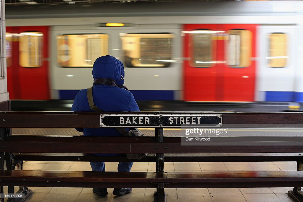 A passenger waits for a train at Baker Street Underground Station on January 9, 2013 in London, England. Baker Street Station shares the 150th Anniversary of its opening on January 10th, 2013 with the London Underground. Commonly called the Tube, the London Underground is the oldest of its kind in the world and now carries approximately a quarter of a million people around its network of 249 miles of track every day. Baker Street station was remodeled between 1911-13 by architect Charles W Clark to its present form as part of a comprehensive rebuilding project by the Metropolitan Railways with the station as its new company headquarters and flagship station, where it quickly became known as the 'Gateway to Metro - Land'. Outside the Marylebone Road exit, a large statue commemorates Sherlock Holmes, Sir Arthur Conan Doyles ficticious detective who resided in the novels at 221B Baker Street.