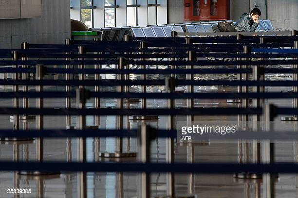 A passenger waits for checkin desk to open for his flight at Larnaca Airport on December 15 2011 as Cyprus government services and airports came to a...