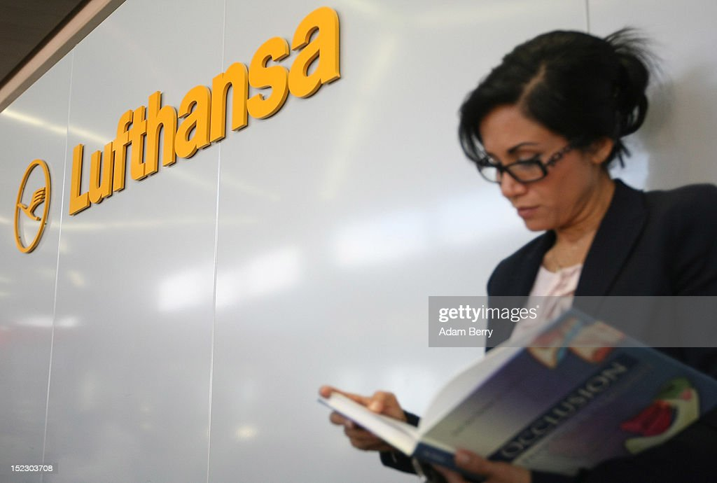 A passenger waits for her Lufthansa flight to Frankfurt on September 14, 2012 at Tegel airport in Berlin, Germany. After the latest in a series of Lufthansa cabin crew strikes led by the flight attendants' union UFO, actions demanding guarantees for job security as well as a five percent salary increase, resulting in nearly 1,800 flight cancellations after 13 months of contract negotiations, the strikers and the airline have agreed upon a former economic adviser to the German government, Bert Ruerup, as an arbitrator, who has stated that he expects a solution by the end of October. The cabin crew union has agreed not to strike over the estimated six weeks of discussions.