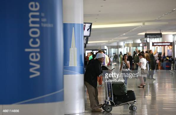 A passenger waits inside the international terminal at San Francisco International Airport on March 13 2015 in San Francisco California According to...
