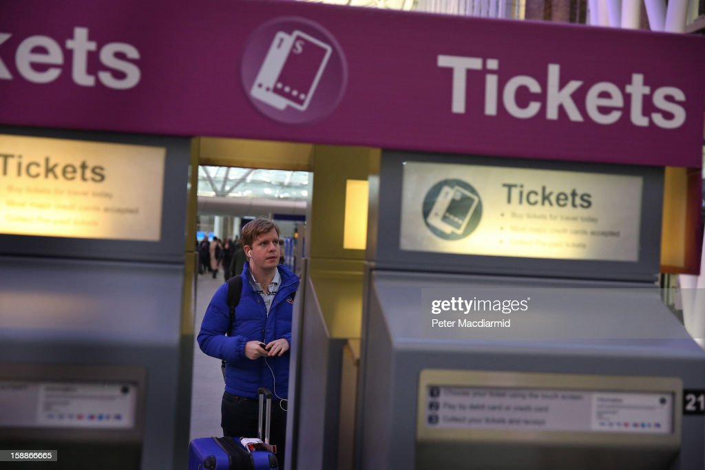 A passenger waits to buy tickets at Kings Cross station on January 2, 2013 in London, England. Rail fares have today risen by an average of 4.2% in England, Scotland and Wales, the tenth year in a row that fares have increased above inflation.