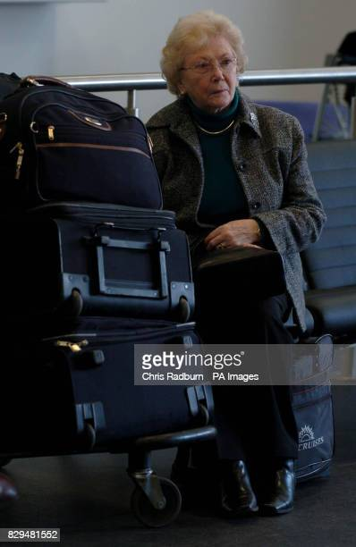 A passenger waits with her suitcases in the PO arrivals lounge after leaving the stricken luxury cruise liner Aurora after PO finally cancelled her...