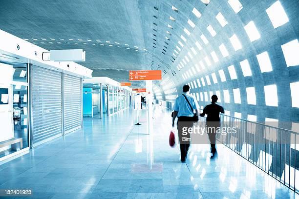Passenger Walking Through an Airport Corridor, Blurred Motion