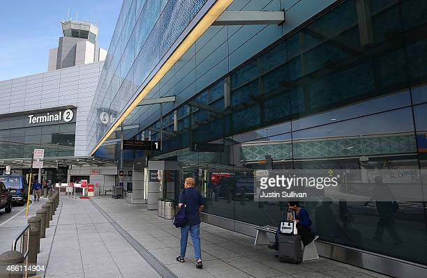 A passenger walks by terminal two at San Francisco International Airport on March 13 2015 in San Francisco California According to a passenger...