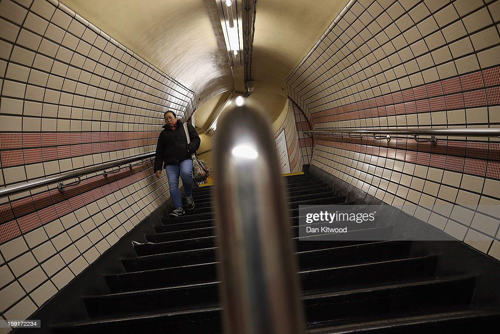 A passenger walks down stairs to board a train at Baker Street Underground Station on January 9, 2013 in London, England. Baker Street Station shares the 150th Anniversary of its opening on January 10th, 2013 with the London Underground. Commonly called the Tube, the London Underground is the oldest of its kind in the world and now carries approximately a quarter of a million people around its network of 249 miles of track every day. Baker Street station was remodeled between 1911-13 by architect Charles W Clark to its present form as part of a comprehensive rebuilding project by the Metropolitan Railways with the station as its new company headquarters and flagship station, where it quickly became known as the 'Gateway to Metro - Land'. Outside the Marylebone Road exit, a large statue commemorates Sherlock Holmes, Sir Arthur Conan Doyles ficticious detective who resided in the novels at 221B Baker Street.