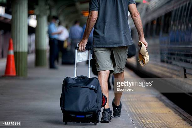 A passenger walks on the platform to board an Amtrak Northeast Regional train at Union Station in Washington DC US on Thursday Sept 3 2015 Secretary...
