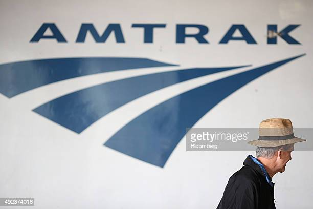 A passenger walks past an Amtrak locomotive inside Union Station in Chicago Illinois US on Thursday Oct 8 2015 The head of Amtrak warned Congress...