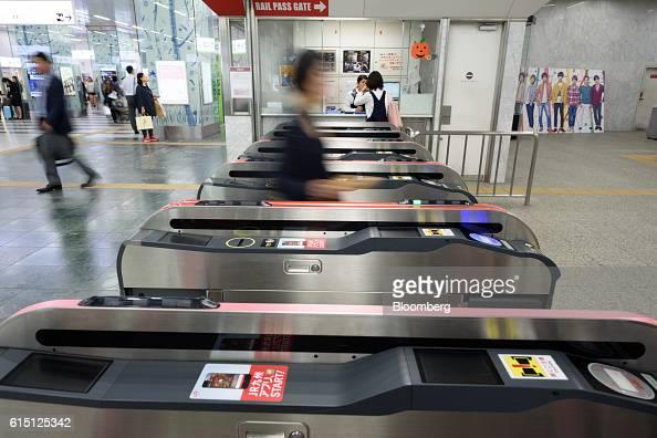 A passenger walks through an automated ticket gate at Hakata Station in Fukuoka Fukuoka Prefecture Japan on Tuesday Oct 11 2016 Kyushu Railway Co the...