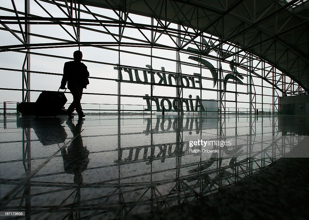 A passenger walks through the Frankfurt airport during a nationwide protest of Lufthansa ground personnel at Frankfurt Airport on April 22, 2013 in Frankfurt, Germany. Workers are demanding pay raises and job guarantees and today's strike has forced Lufthansa to cancel approximately 1700 flights.