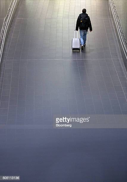 A passenger wheels luggage inside the departure terminal at Vienna International Airport operated by Flughafen Wien AG in Vienna Austria on Friday...