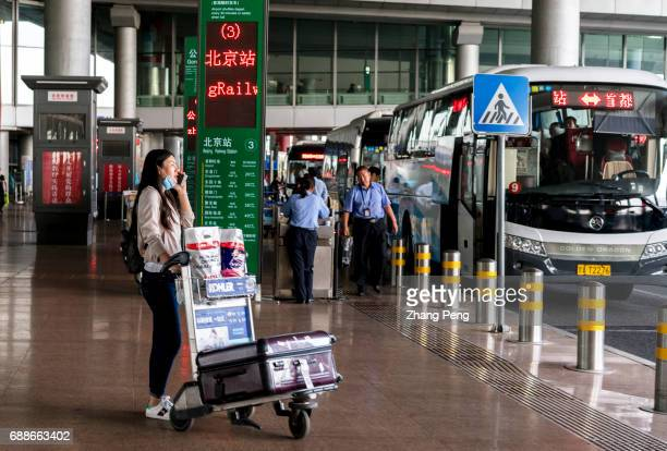 A passenger who just arrived is waiting for the airport bus in Terminal 3 of Beijing Capital International Airport According to China CAAC China will...