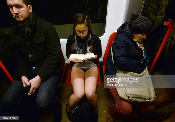 A passenger without pants sits on a subway train and reads a book during the 'No Pants Subway Ride' on January 10 2016 in Prague The No Pants Subway...