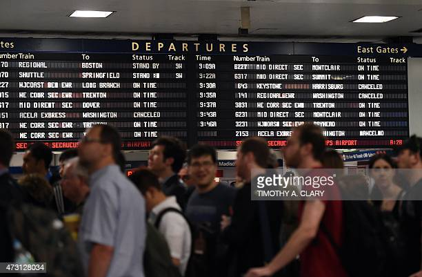 Passengers and others injured in an Amtrak train derailment who were bused from to New York from Philadelphia wait at Penn Station May 13 2015 in New...