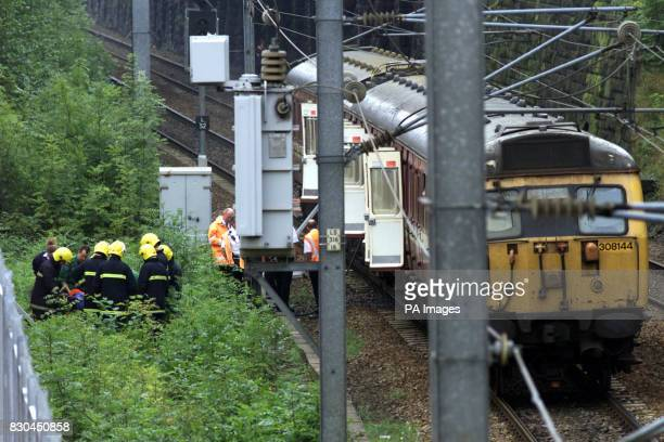 Passengers are evacuated from a train after the middle carriage of the passenger train caught fire at the old Armley railway station on Canal Road...
