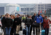 Passengers are evacuated from Zaventem Bruxelles International Airport after a terrorist attack on March 22 2016 in Brussels Belgium At least 13...
