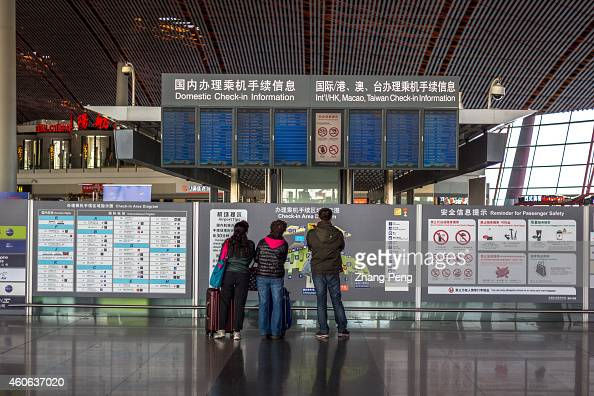 Passengers are reading flight message in Terminal 3 of Beijing International Airport China will become the leading country for passenger air traffic...