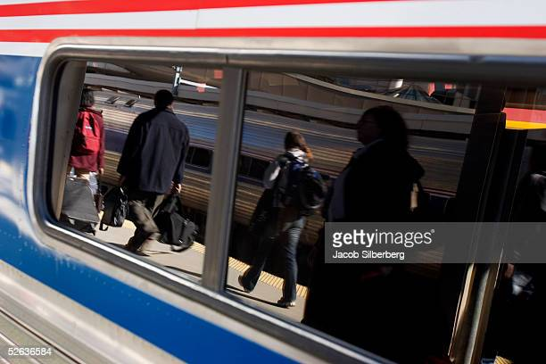 Passengers are reflected in the window of a train April 1 2005 in Boston Massachusetts Over 25 million passengers rode Amtrak last year