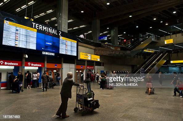 Passengers are seen at Sao Paulo International Airport in Guarulhos Brazil on November 8 2013 AFP PHOTO / Nelson ALMEIDA
