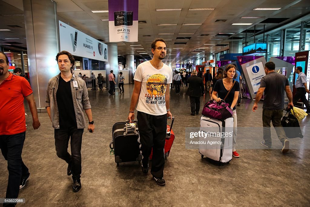 Passengers are seen at the Ataturk International Airport after the air traffic returned to normal following yesterday's terror attack in Istanbul, Turkey on June 29, 2016. At least 36 victims and three suicide bombers were killed while scores of others were injured in a terror attack on Istanbuls Ataturk International Airport.