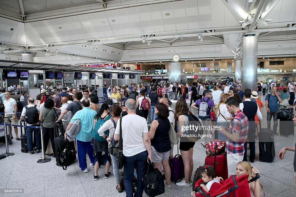 Passengers are seen at the Ataturk International Airport after the air traffic and working process returned to normal following terror attack in Istanbul, Turkey on July 1, 2016.