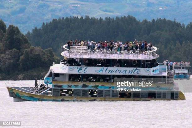 Passengers are seen onboard the tourist boat Almirante in the Reservoir of Penol in Guatape municipality in Antioquia on June 25 2017 At least nine...