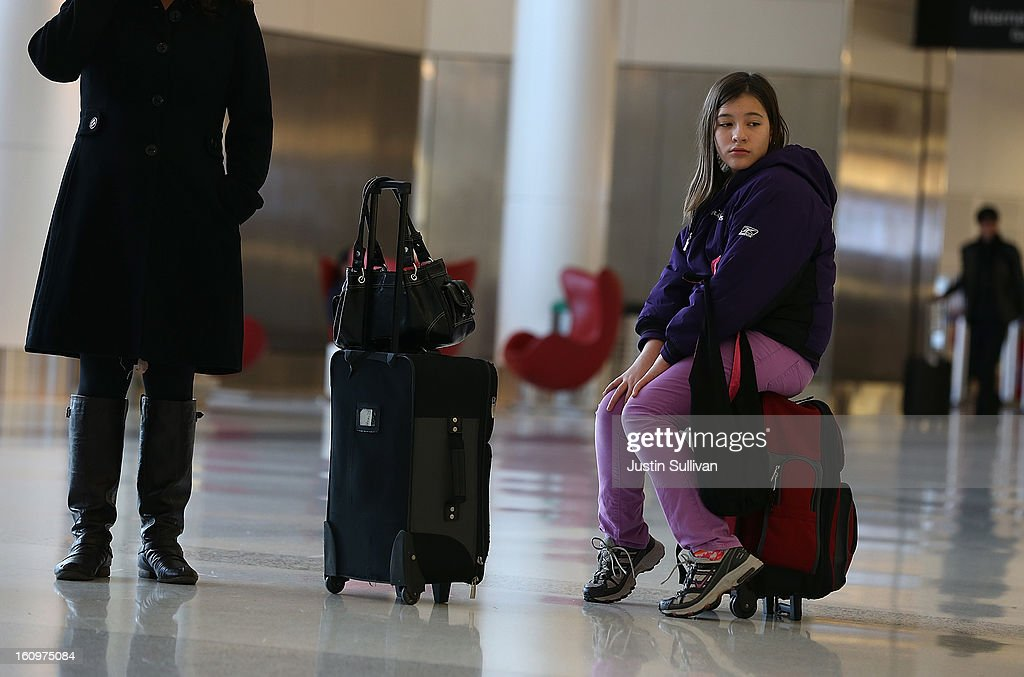 Passengers are seen waiting in terminal 2 at San Francisco International Airport on February 8, 2013 in San Francisco, California. Thousands of flights to the East Coast were canceled as a potentially historic blizzard is set to dump up to three feet of snow in the Northeast from New York City to Boston.