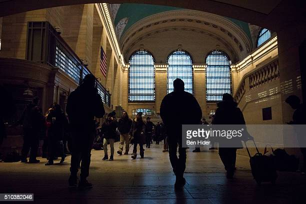 Passengers are seen walking through the dark concourse of Grand Central Terminal during a power outage on February 15 2016 in New York City A broken...