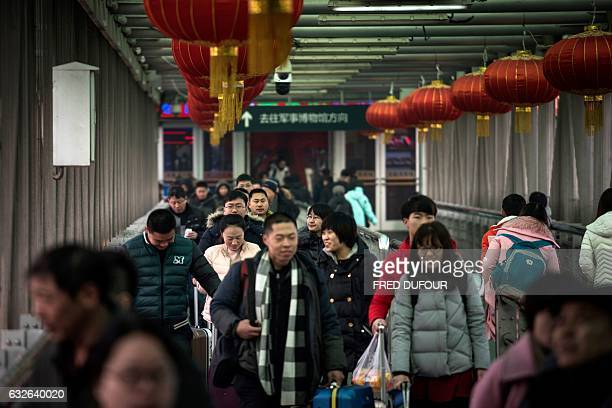Passengers arrive at Beijing West Railway Station to travel to their hometowns for the 'Spring Festival' or Lunar New Year in Beijing on January 25...