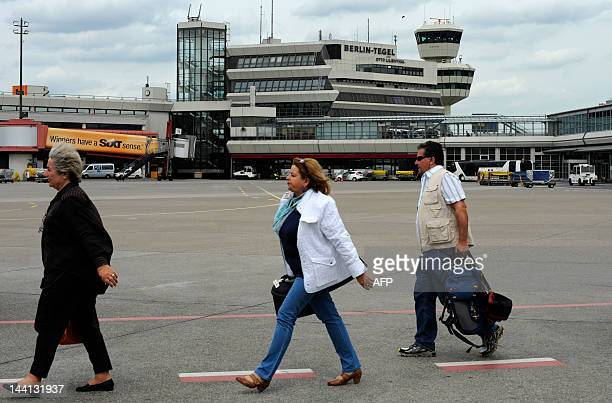 Passengers arrive at Berlin's Tegel airport on May 10 2012 The scheduled opening of Berlin's new main airport Willy Brandt Berlin Brandenburg...