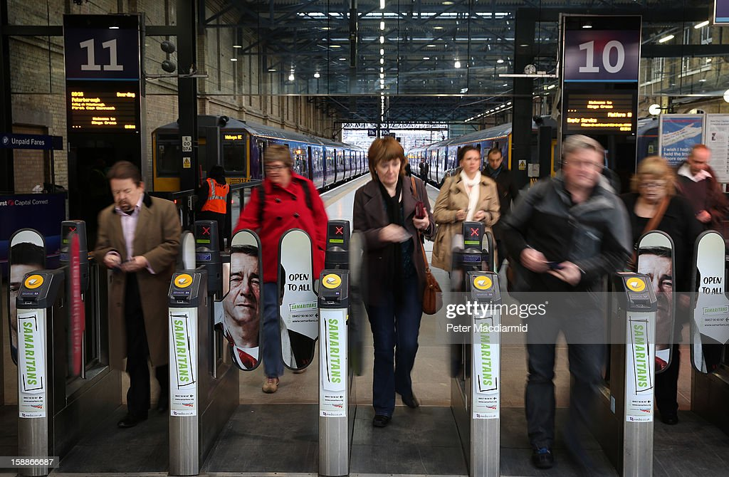 Passengers arrive at Kings Cross station on January 2, 2013 in London, England. Rail fares have today risen by an average of 4.2% in England, Scotland and Wales, the tenth year in a row that fares have increased above inflation.
