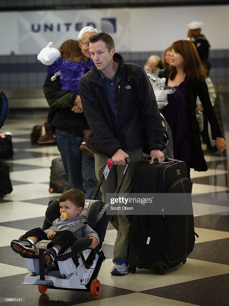 Passengers arrive at O'Hare International Airport on November 21, 2012 in Chicago, Illinois. The Chicago Department of Aviation anticipates nearly 1.8 million passengers will travel through Chicago's two airports for the Thanksgiving holiday travel period between Tuesday, November 20 and Tuesday November 27.
