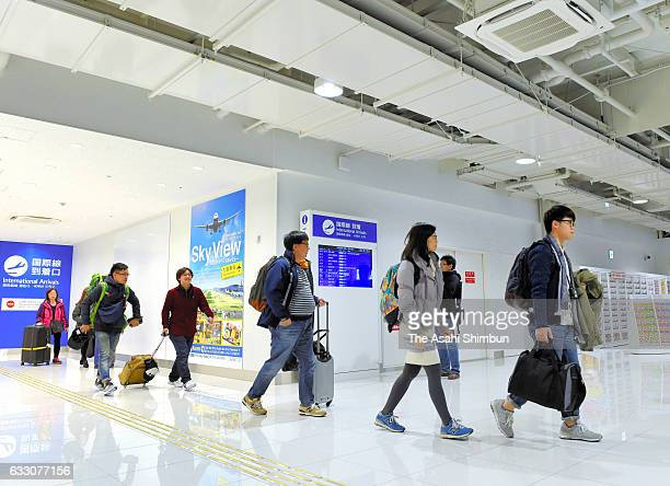 Passengers arrive at the new terminal for low cost carriers at Kansai International Airport on January 28 2017 in Izumisano Osaka Japan