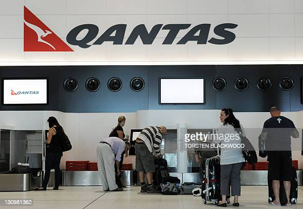 Passengers arrive at the Qantas self checkin at Perth Airport on October 31 2011 Qantas resumed operations after the shock grounding its planes on...