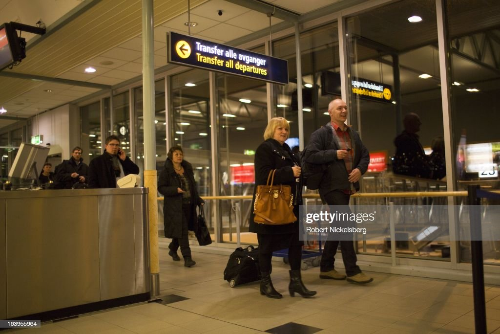 Passengers arrive at the Tromso Airport March 8, 2013 in Tromso, Norway. Tromso is 217 miles (350 kms) north of the Arctic Circle.