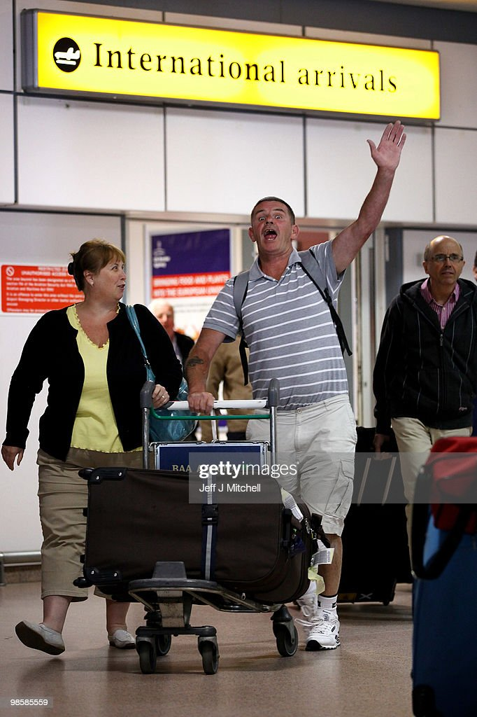 Passengers arrive back from Lanzarote after the airspace was shut down for six days due to volcanic ash on April 21, 2010 in Glasgow, Scotland. UK airports reopened on Tuesday night when safety test showed aircraft engines were able to cope in low density ash.