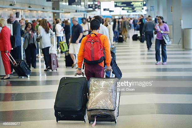Passengers arrive for flights at O'Hare International Airport May 23 2014 in Chicago Illinois Chicago's O'Hare and Midway International Airports...