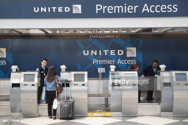 Passengers arrive for flights at the United Airlines terminal at O'Hare International Airport on April 12 2017 in Chicago Illinois United Airlines...