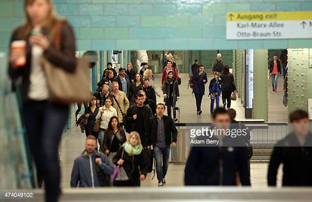 Passengers arrive from a local train at Alexanderplatz train station during a train strike on May 20 2015 in Berlin Germany German rail carrier...