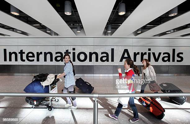 Passengers arrive in Heathrow airport's Terminal 5 on April 21 2010 in London England Airlines are beginning to resume a normal service following six...