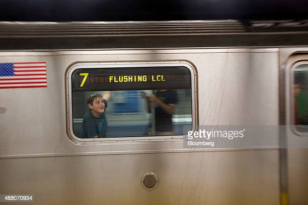 Passengers arrive on a 7 train at the Hudson Yards subway station in New York US on Sunday Sept 13 2015 The $242 billion 15 mile extension of the 7...