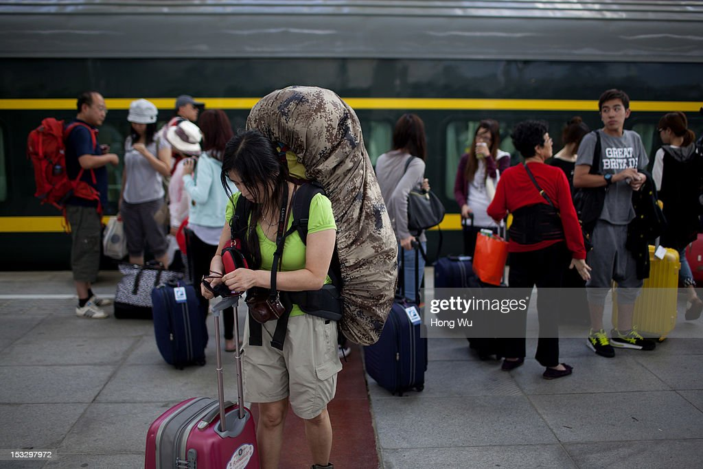 Passengers arrived at Lhasa Railway Station after taken a train from Beijing to Lhasa on August 15, 2012 in Lhasa, China. After Qinghai-Tibet Railway went into operation on July 1, 2006, connecting China's capital Beijing and Lhasa of Tibet Autonomous Region by 4,064 km of railway line. Passengers and supplies are transported by train on this the world's highest railway to Tibet.