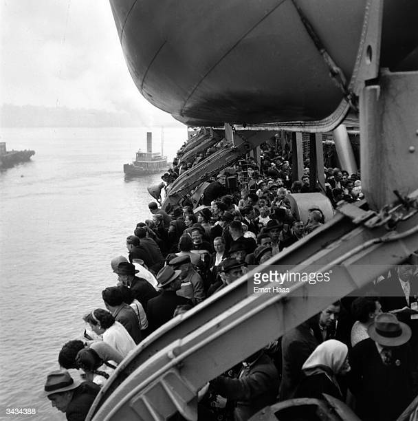 The last boatload of displaced persons from World War II arriving at Ellis Island New York from Europe In black and white book