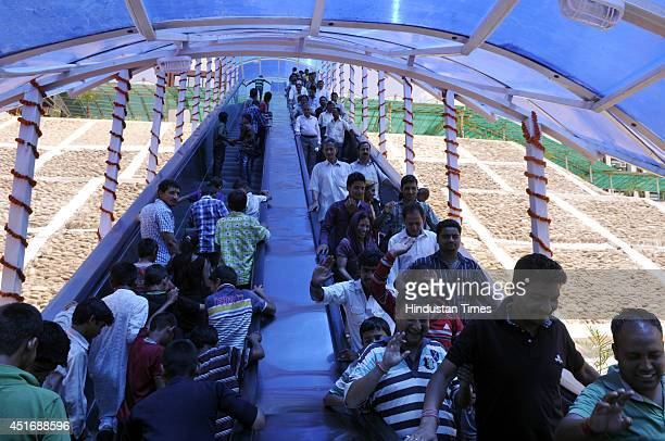 Passengers at Katra Railway station after the inauguration of the KatraUdhampur rail link on July 4 2014 in Jammu India Prime Minister Narendra Modi...