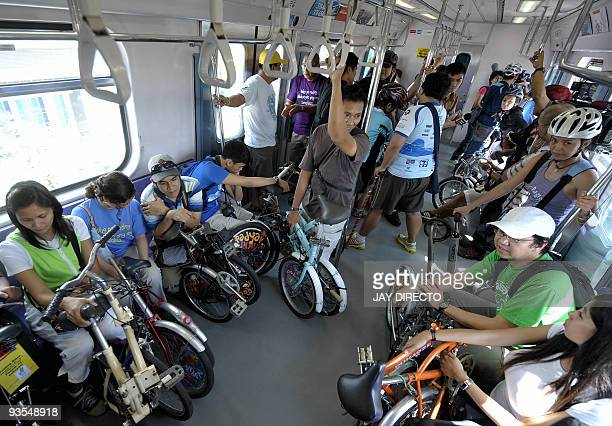 Passengers at Manila's lightrail transit hold their foldable bicycles en route to a station and bike to their final destinations November 8 2009...