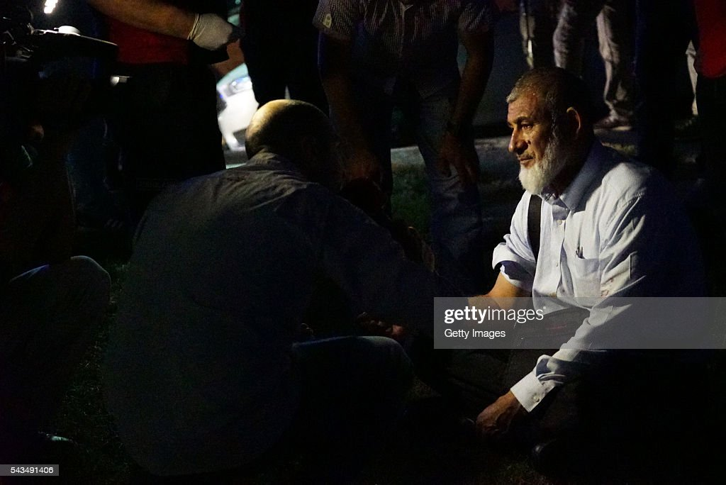 A passenger's blood pressure is checked by health officals outside Turkey's largest airport, Istanbul Ataturk, on June 28, 2016 in Istanbul, Turkey. Three suicide bombers opened fire before blowing themselves up at the entrance to the main international airport in Istanbul, killing at least 28 people and wounding at least 60 people, according to Istanbul governor Vasip Sahin.