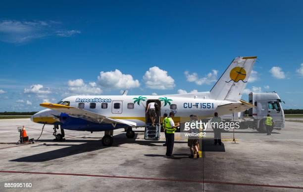 Passengers boading a Aero Caribbean flight